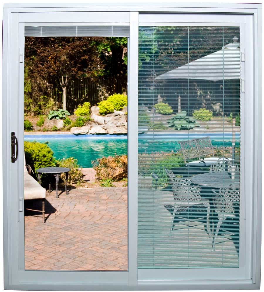 An opened sliding glass door with mini blinds