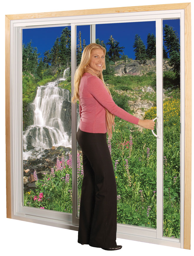 A woman opening clear sliding glass doors
