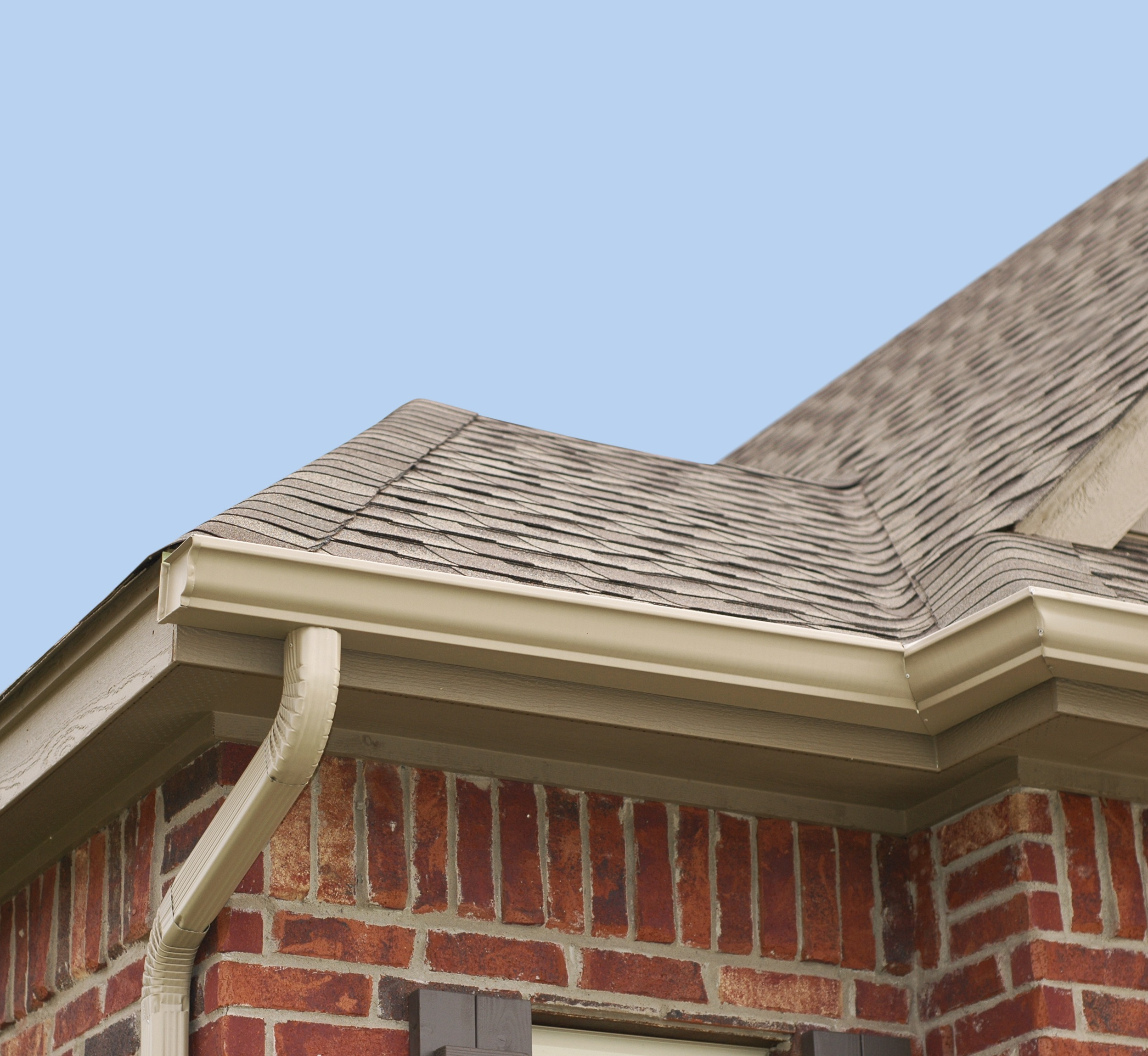 Tan gutters on a house with matching roof colors