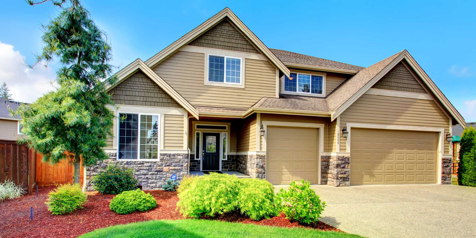 A clean house with professionally installed tan siding