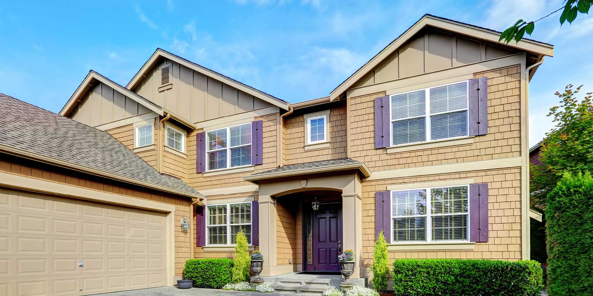 A house with professional siding in Cream or Maple color