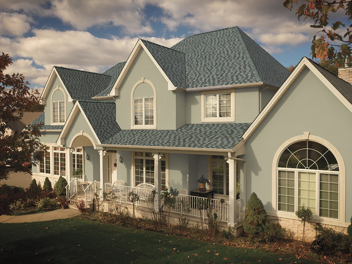 A house with Biscayne Blue colored shingles